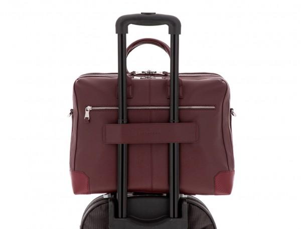 maletín de viaje de piel en color burdeos trolley