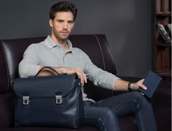 leather briefbag with flap in blue lifestyle