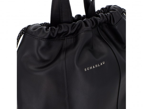 leather flat backpack in black clasp