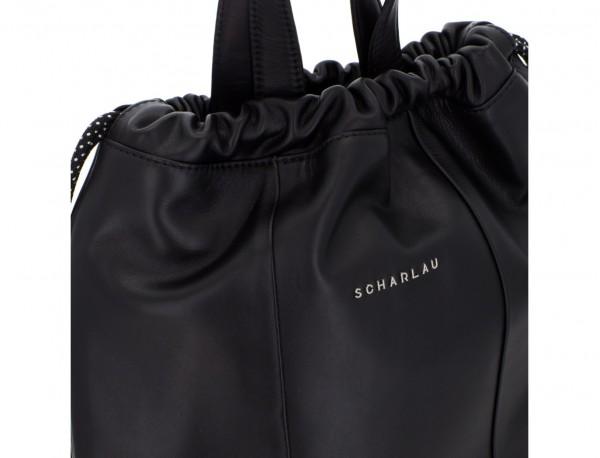 mochila plana de piel negra cierre