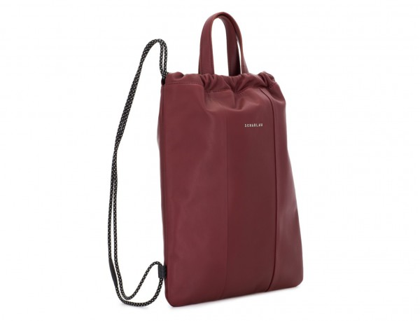 leather flat backpack in burgundy side