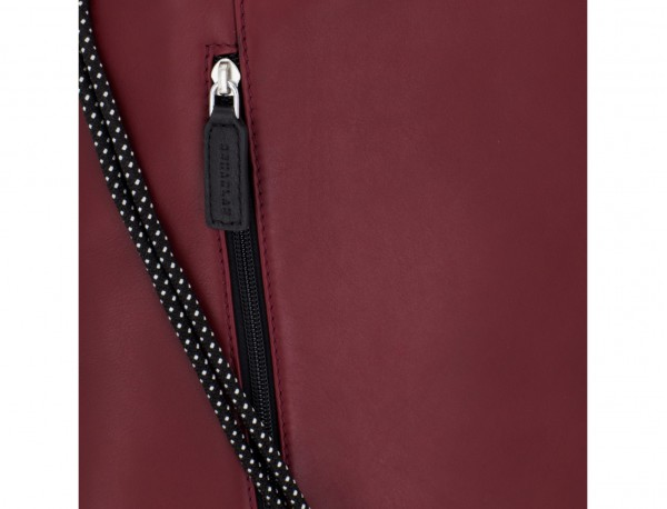 leather flat backpack in burgundy detail