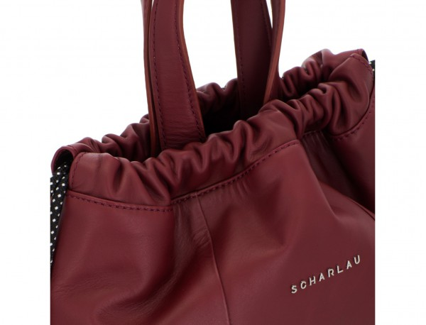 leather flat backpack in burgundy clasp