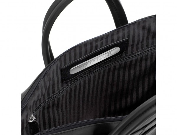 maletín de piel negro placa