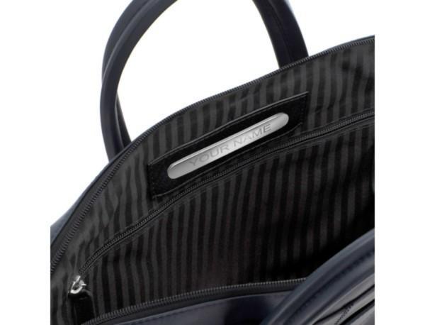 maletín de piel azul  placa