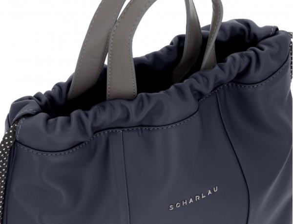 mochila plana de piel azul asas