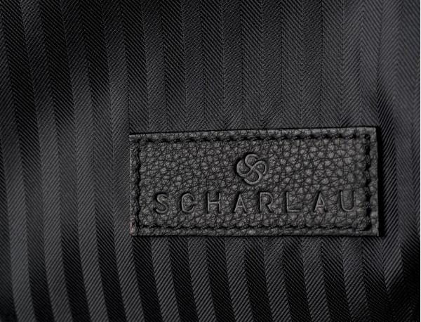 Porta trajes fino en negro detalle logo