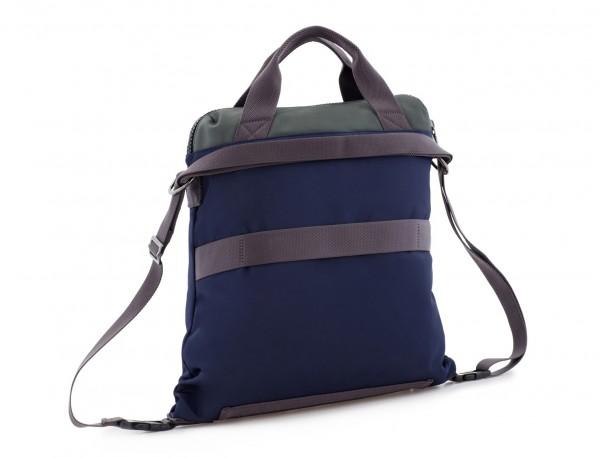 Bolso tote versátil convertible en mochila en azul detrás