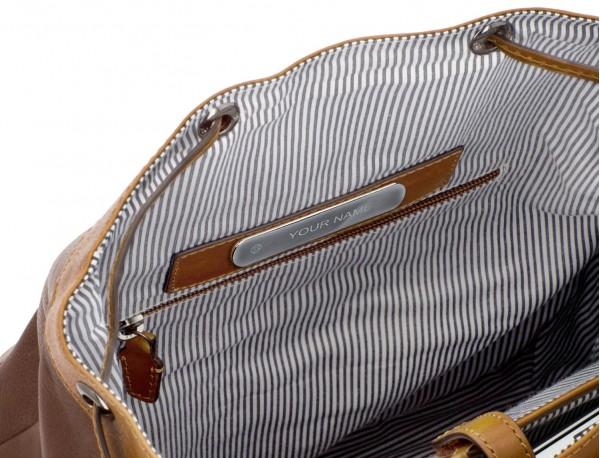 mochila de piel vintage marrón interior