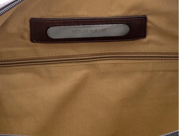 neceser de aseo en lona de color verde placa personalizada