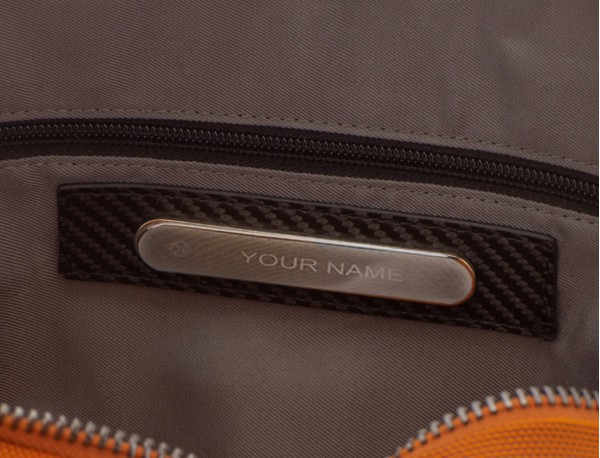 travel backpack tube in anthracite black personalized metal plate