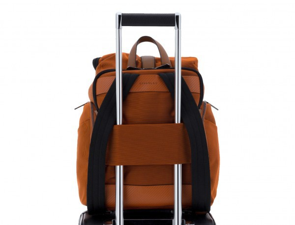 Travel backpack with flap in orange trolley