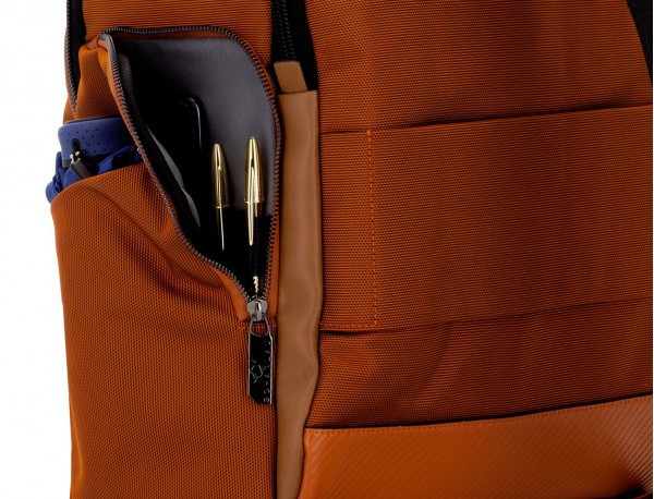 Travel backpack with flap in blue pockets detail