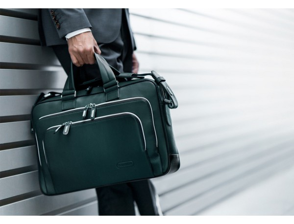 leather business bag in green lifestyle