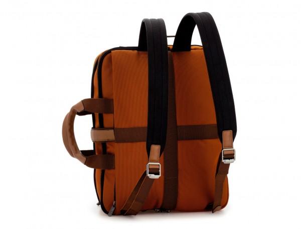 Maleta de viaje mochila en naranja detrás