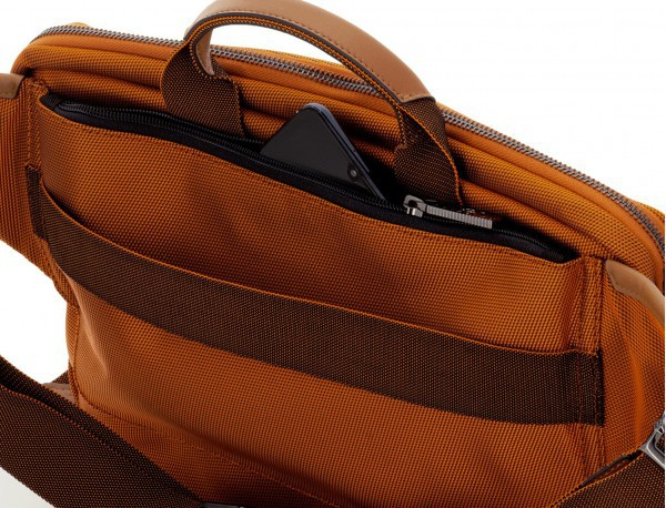 Riñonera grande de nylon en color naranja bolsillo antirrobo