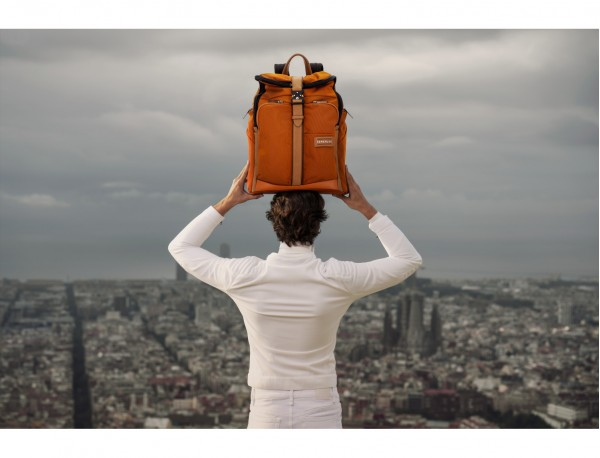 Travel backpack with flap in orange lifestyle