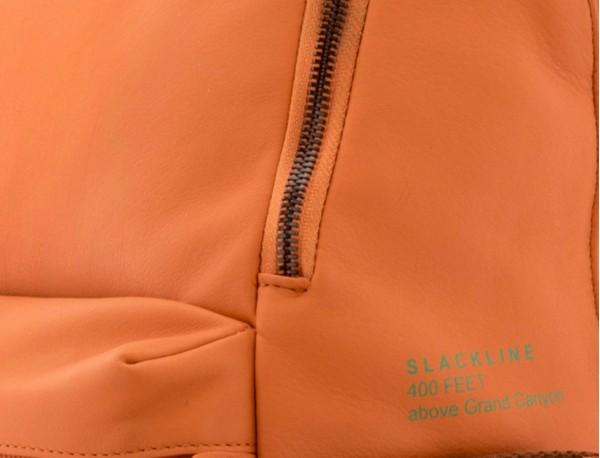 leather orange backpack detail