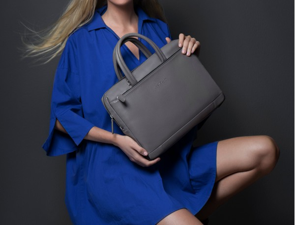 small leather briefcase in gray woman